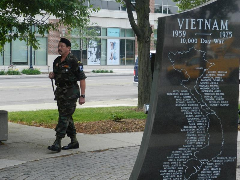 Tony Gramer and other Vietnam War vets take turns walking around the war memorial at Dearborn city hall