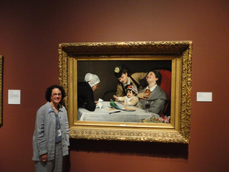 "DIA docent Andrea Simons with ""The Merrymakers."""
