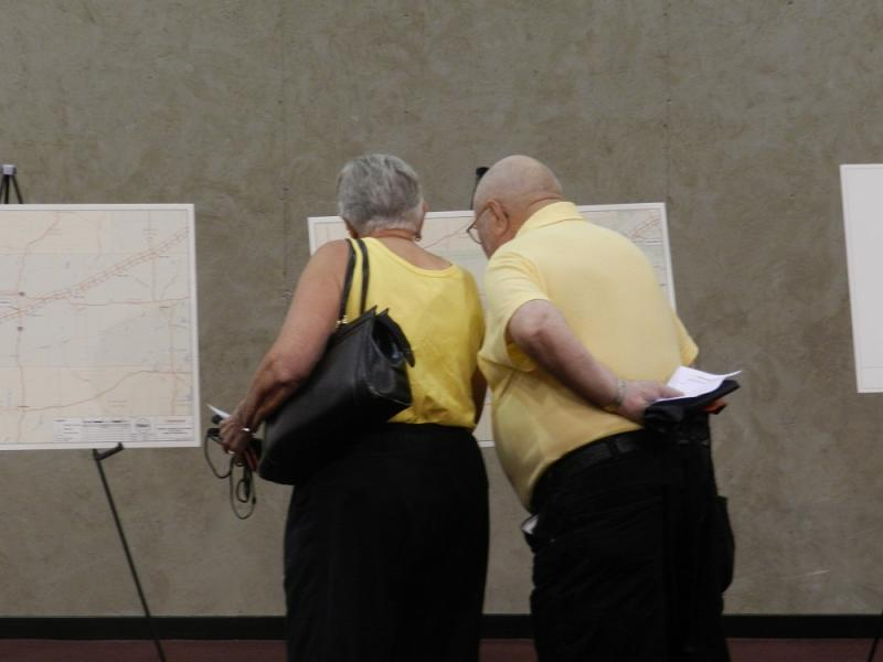 During an open house in Marshall, a couple looks at a map of the proposed route of a new crude oil pipeline that would travel along a diagonal line across southern Michigan
