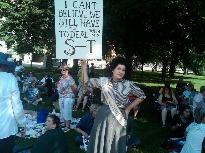 "Thousands of people gathered last night at the state Capitol to protest with a staging of the ""Vagina Monologues."""