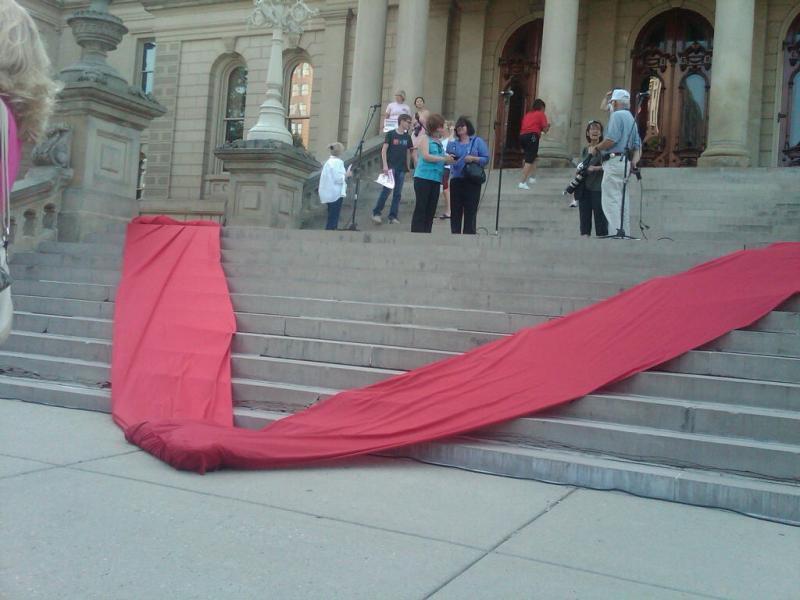 "A red letter ""V"" on the state Capitol steps"