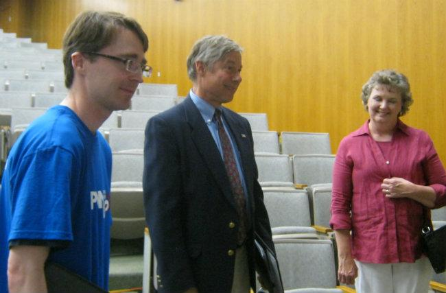 Congressman Fred Upton talks with supporters after the debate Sunday night in Kalamazoo.