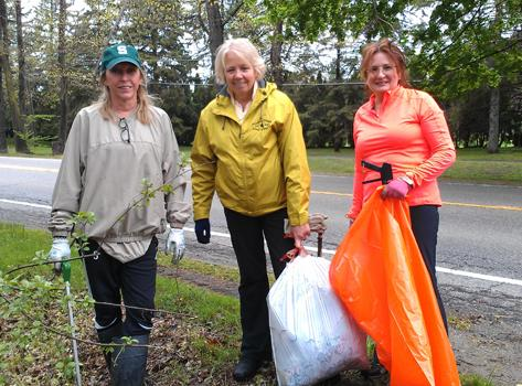 (L to R) Moy Garretson, Karen Rooke and Melinda Fons spend some of their free time picking up trash while they're out on walks together. They say it's more fun than working out at the gym.
