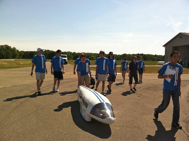 The Penn State University team heads toward the track.