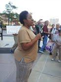 Jennifer Britt talks to supporters outside the McNamara Federal Building in Detroit.