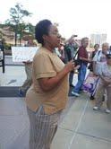 Jennifer Britt talks to supporters outside the McNamara Federal Building in Detroit.