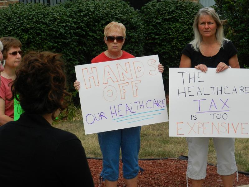 Americans for Prosperity picket outside U.S. Sen. Debbie Stabenow's  (D-MI) office in East Lansing