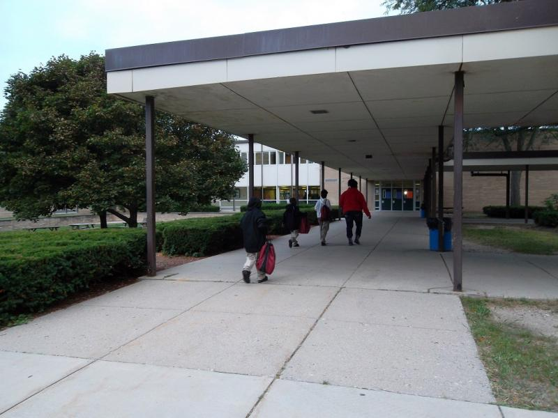 Children entering Lansing STEM Academy (STEM stands for Science, Technology, Engineering, and Mathematics)