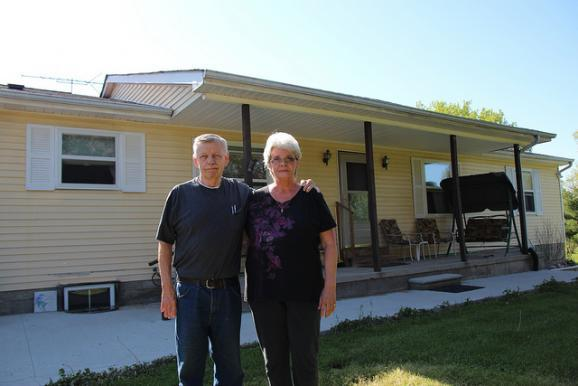 Tom and Connie Watson in front of their home. The couple says they were not satisfied with offers Enbridge made to gain additional easement on their property.