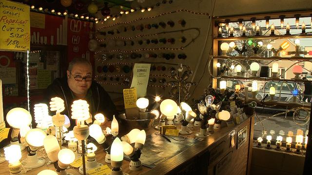Lighting store owner Larry Birnbaum shows off his collection of antique and modern lighting.