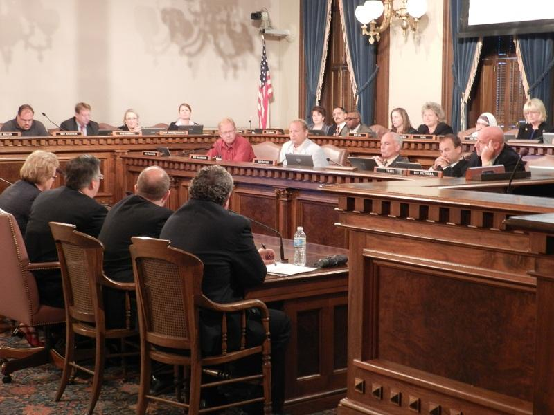 State lawmakers listen during testimony before a joint state House committee hearing on health insurance exchanges