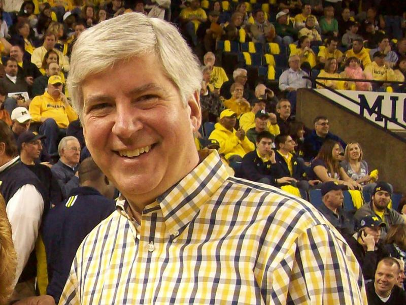 MichigaMichigan Gov. Rick Snyder at a Univ. of Michigan basketball game.n Gov. Snyder gets cagey on subject of weight loss.