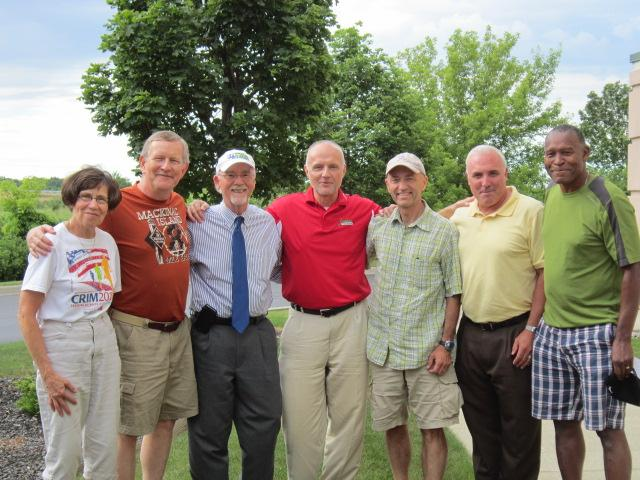 These are some of the 70 Crim Race runners and walkers who have participated in at least 30 consecutive races in their hometown event. They are, from left, Karen Bell, John Jerome, Brian Barkey, David Cole, David Smith, Mike Kildee and Curtis Thompson.