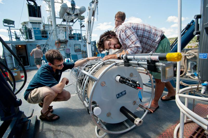 "Jay Austin (L) is an Associate Professor at the University of Minnesota-Duluth. He and assistant scientist Matt James are shown here prepping the device, an ""autonomous moored platform"" for its test dive."
