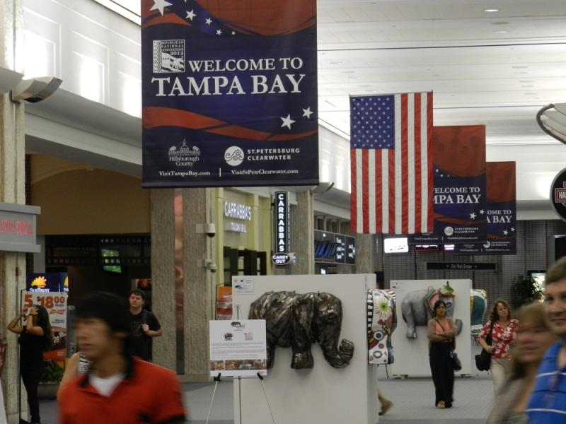 Banners hang in the main terminal building at Tampa International Airport greeting people coming to town for the Republican National Convention