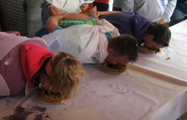 The first few seconds of a blueberry pie eating contest Friday afternoon in South Haven.