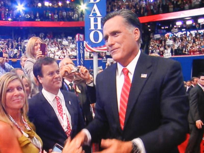 Mitt Romney shakes hands with supporters at last night's Republican National Convention in Tampa, Florida