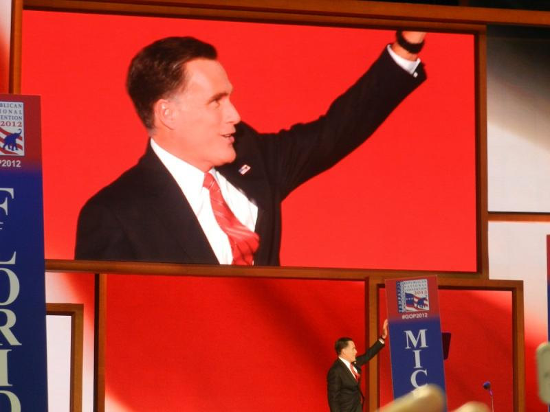 Mitt Romney waves to the crowd at last night Republican National Convention in Tampa, Florida