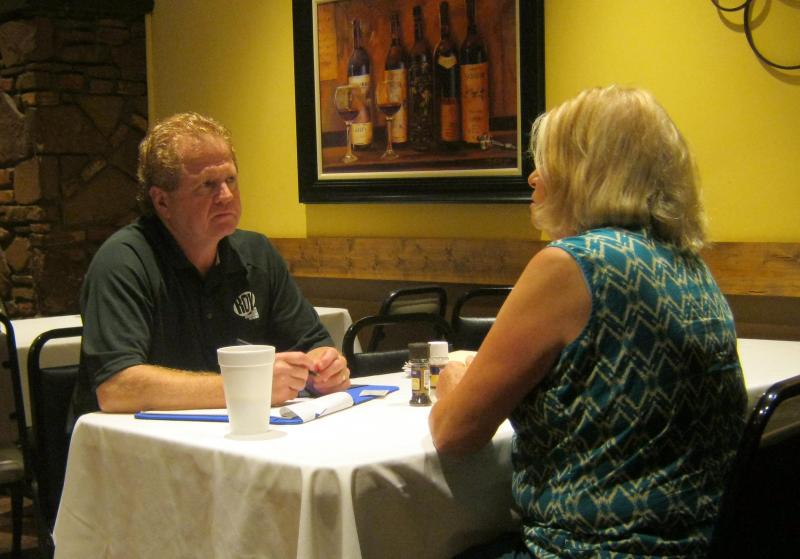 State Representative Roy Schmidt (R-Grand Rapids) meets with a realtor during his coffee hours Tuesday morning.