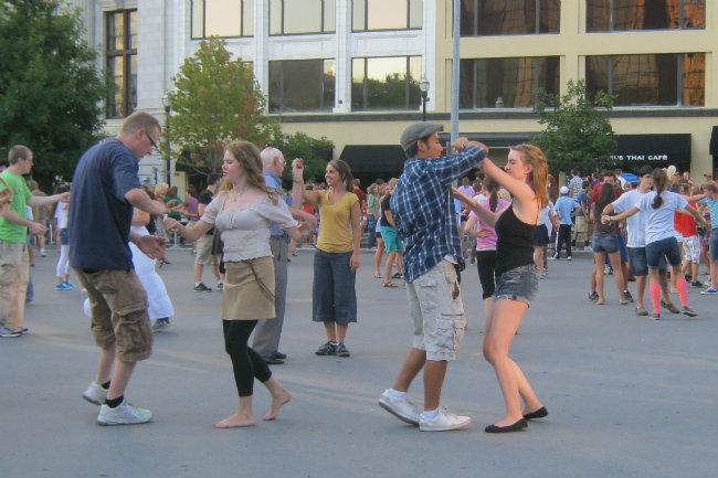 People swing dance in Rosa Parks Circle in downtown Grand Rapids Tuesday nights during the summer.