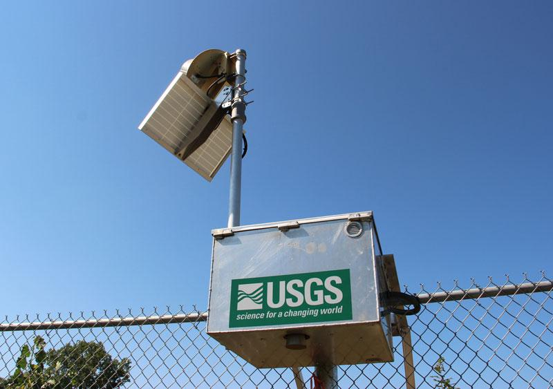 As an added component of floodwater monitoring, the U.S. Geological Survey installed gages on the fence that will measure water levels in effort to ensure the fence does not block water flow during significant flooding events.