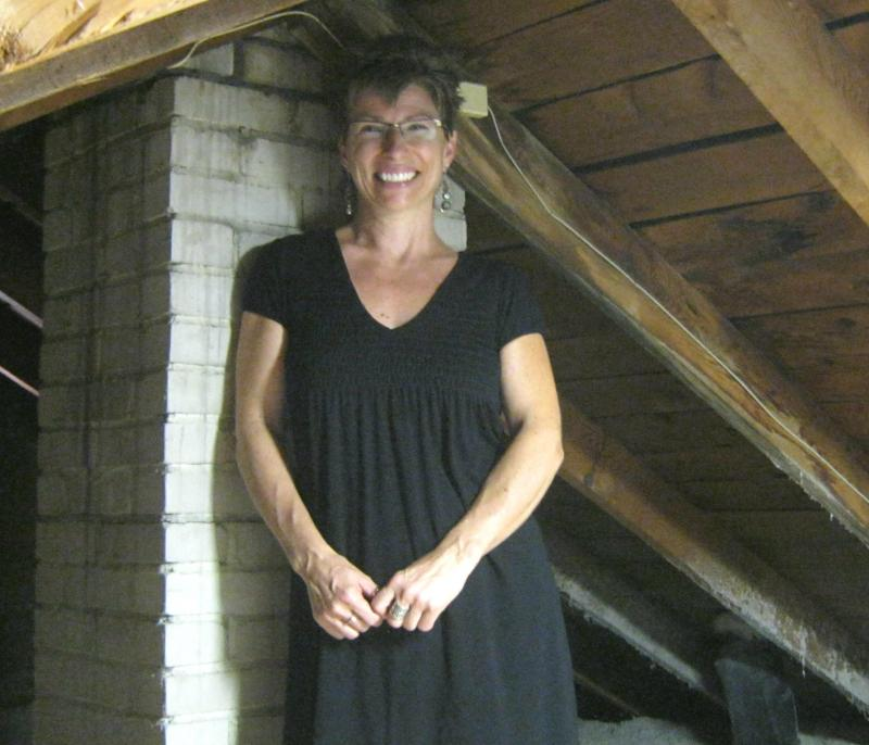 Sara Potyraj in the attic of her home in Grand Rapids. A low-interest loan allowed her to make improvements that'll add up to big savings in her energy bills.