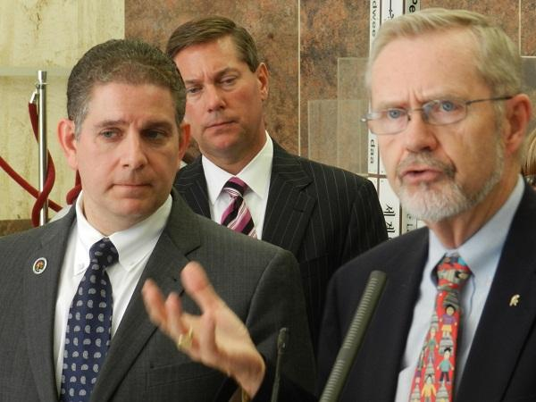 Former Lansing mayor David Hollister (right) speaks during a news conference.   Mayor Virg Bernero (left) announced the formation of a panel to study the city's financial problems.