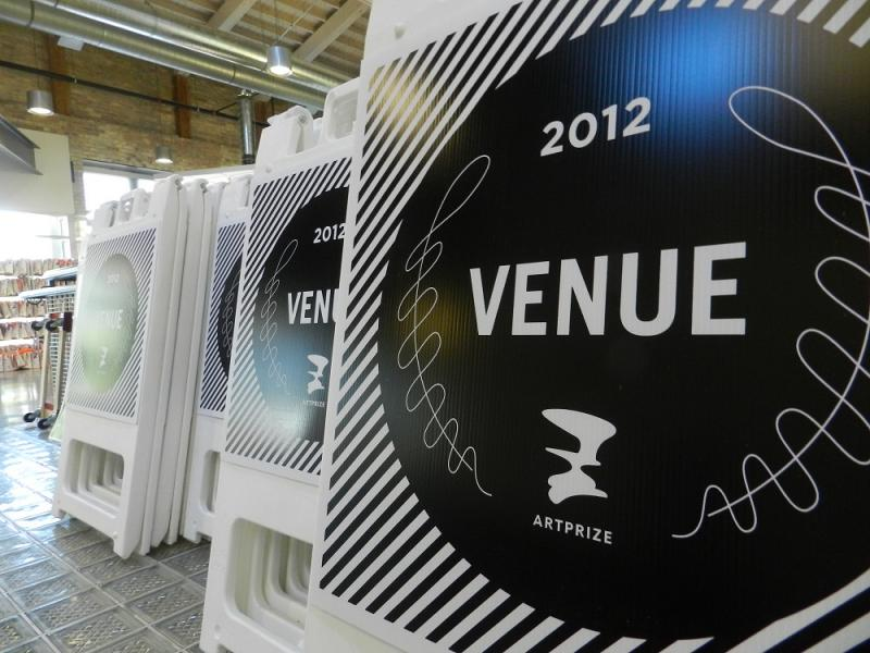 "Venue signs stacked up inside ""The Hub"" which is the staging area and control center for Art Prize 2012"