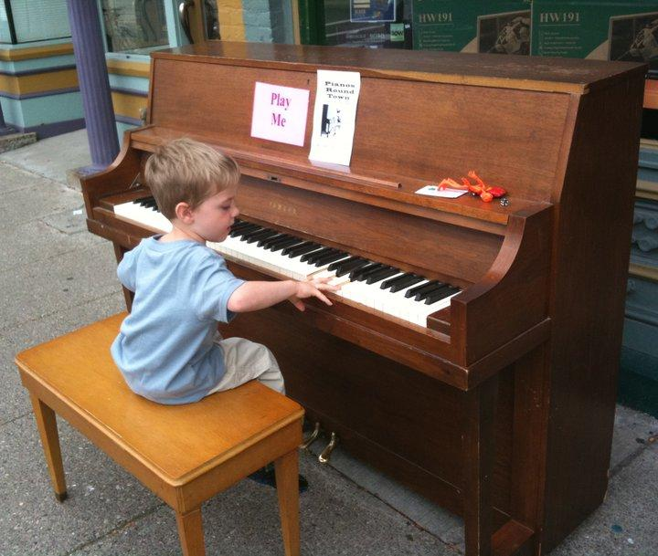 A young pianist plays on Cross St., Ypsilanti. 2010.