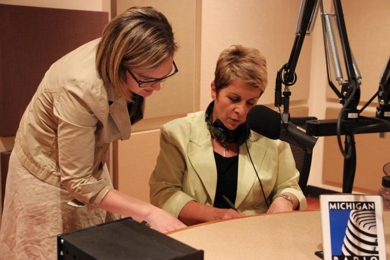Executive Producer of Stateside Zoe Clark (l) and Host Cynthia Canty (r) go over some notes for the show.
