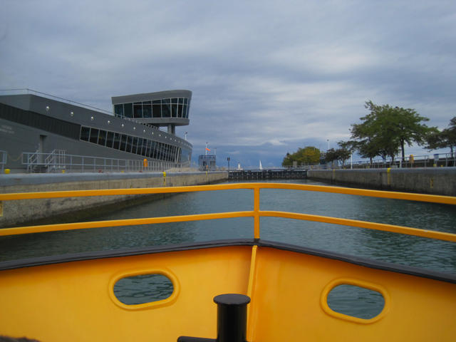 A tour boat heading into the locks on the Chicago River.