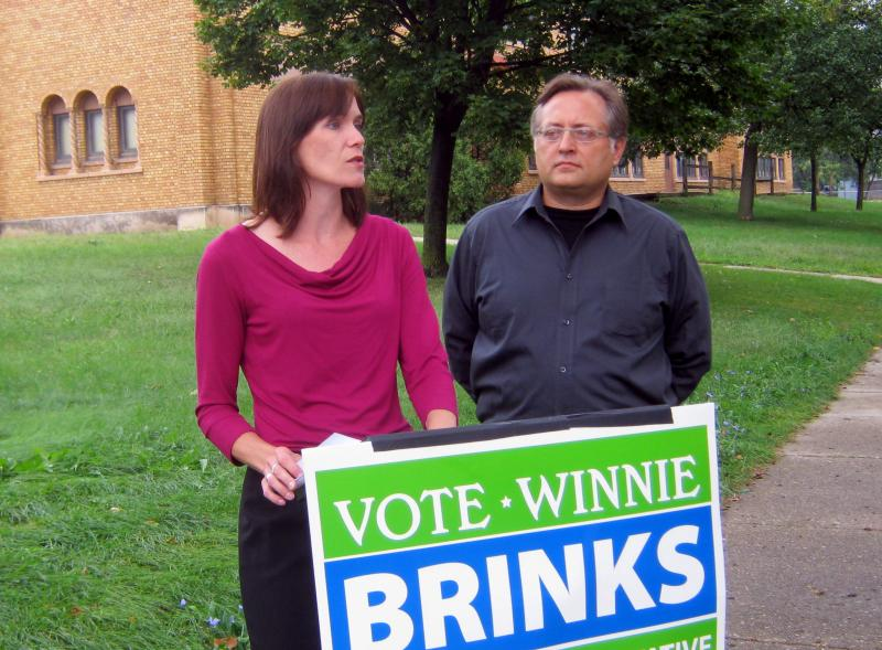 Democratic candidate Winnie Brinks stands with Grand Rapids Public Schools' parent Matthew Patulski in front of Stocking Elementary School. The school closed two years ago.