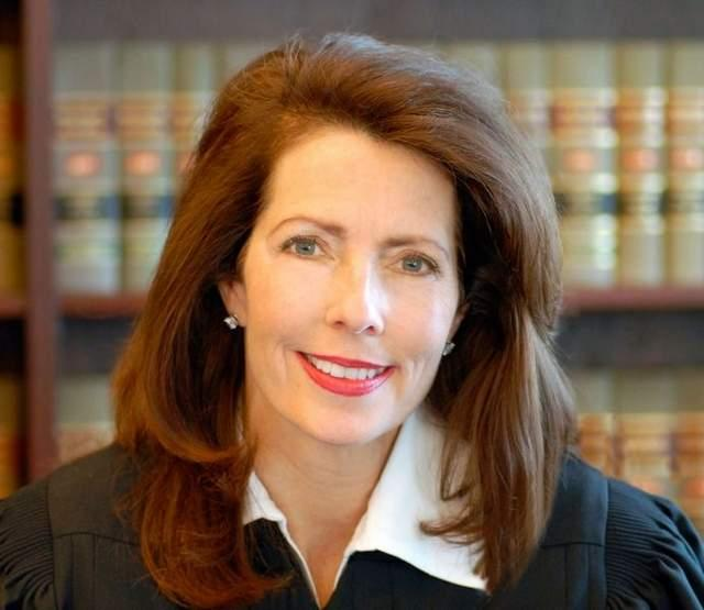 Michigan Supreme Court Justice Diane Hathaway plans to fight the federal government's lawsuit.