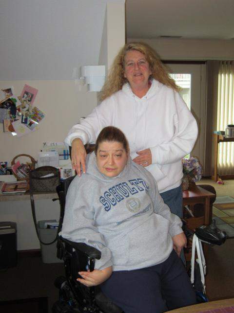 Elizabeth Schultz and her caregiver of eight years, Leah Kroll, both of Holland.