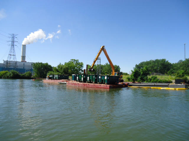 Dredging on the River Raisin. A mechanical dredge removing material on July 11, 2012.