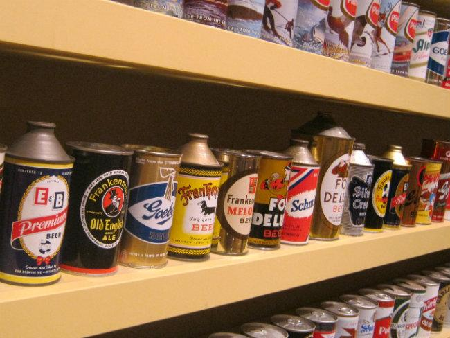 Rows and rows of collectable beer cans, mostly from Michigan.