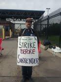 A striking worker outside the Detroit wastewater plant Monday.