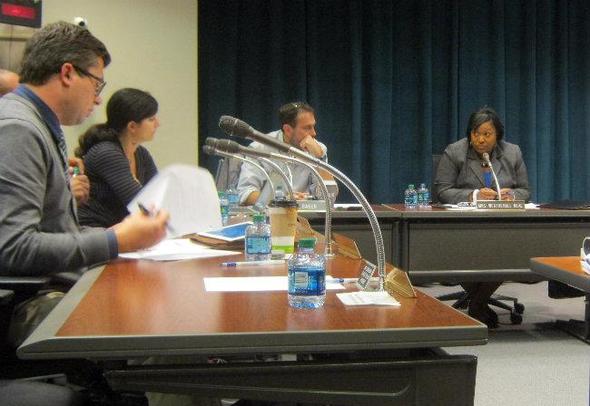 Supt. Teresa Weatherall Neal (right) discusses the transformation plan with the school board Monday night.