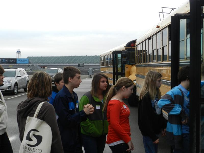7th grade students from Dundee board buses at Michigan International Speedway as part of the new Track and Explore program