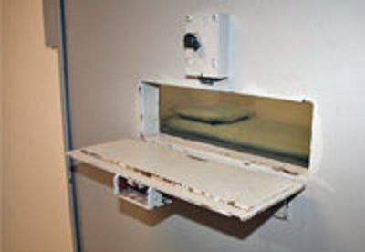 An isolation cell is shown on the cover of a 141 page report on the effects of solitary confinement on teenage offenders