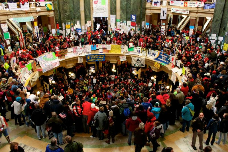 Protesters in Wisconsin's State Capitol in March 2011 after the legislature stripped public sector collective bargaining rights. Activists in Michigan are seeking to enshrine their rights in the state Constitution.