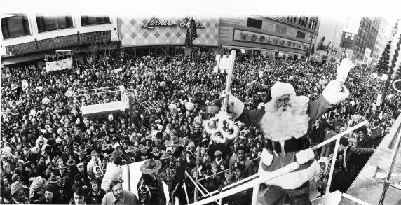 Santa holds the key to the city of Detroit before the crowds on Woodward Ave. at the conclusion of the parade (c. 1960)