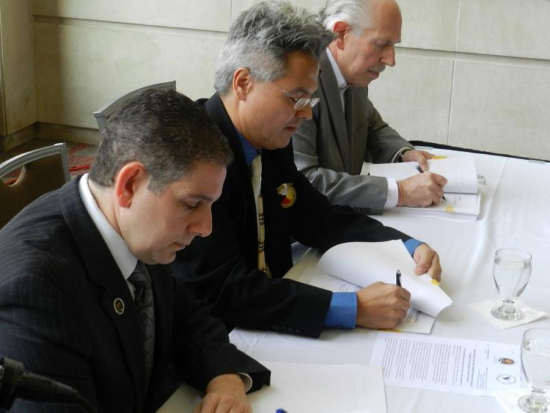 Lansing Mayor Virg Bernero (left), Sault Ste. Marie tribal chairman Aaron Payment, and Lansing Future Development LLC's Bob Liggett sign an agreement to purchase three parcels of land next to the Lansing Center