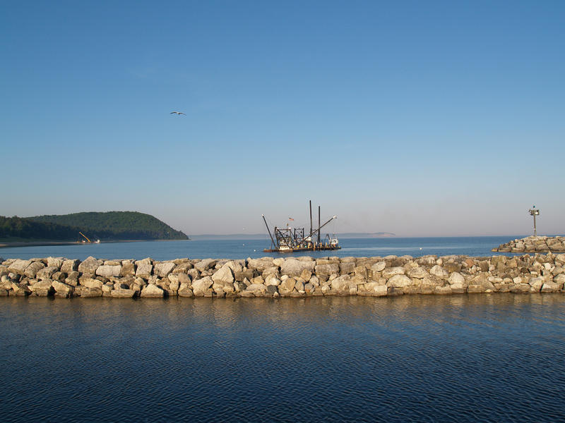 A dredge operating outside of the harbor in Leland, Michigan.