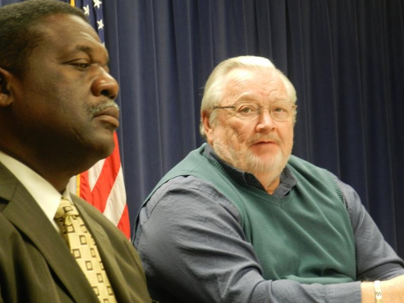 Flint Public Safety Chief Alvern Lock (left) listens as Emergency Financial Manager Ed Kurtz speaks at a news conference concerning Tuesday's ballot proposals on marijuana and Michigan's Emergency Manager law.