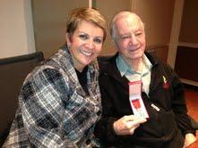 Glenn Dickerson displayed his newly awarded medal for Cyndy