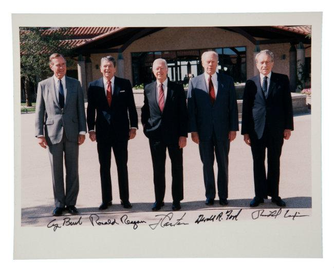 A signed, color photo of  Gerald Ford with George H. W. Bush, Ronald Reagan, Jimmy Carter, and Richard Nixon