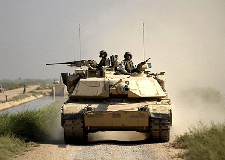 An M1A1 Abrams Main Battle Tank in Iraq in 2004. Components of the tank are built in Michigan.