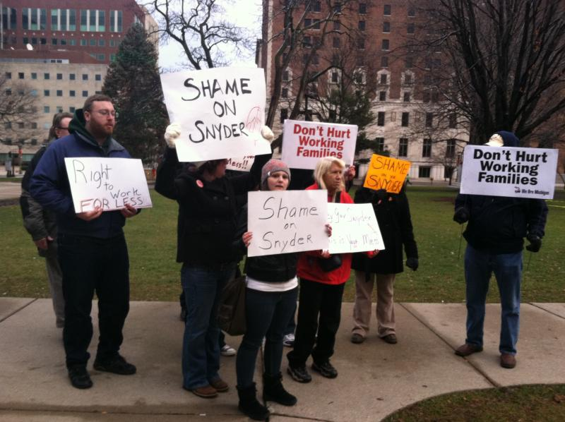 "A small cluster of protesters oppose so-called  ""right-to-work"" legislation outside the state Capitol on  Saturday."