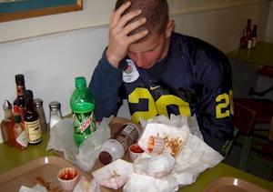 This Blimpy Burger patron just heard the news--or he has a stomachache.